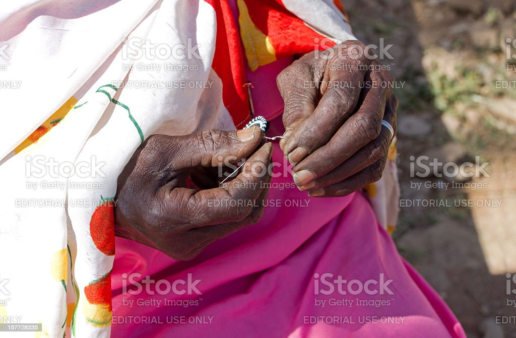 Making Maasai Bead Jewelry royalty-free stock photo