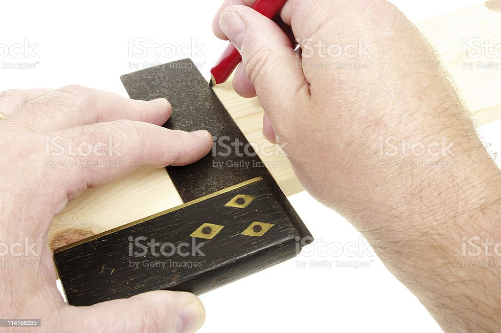 Making Mark Across Timber With Carpenter's Pencil And Square stock photo