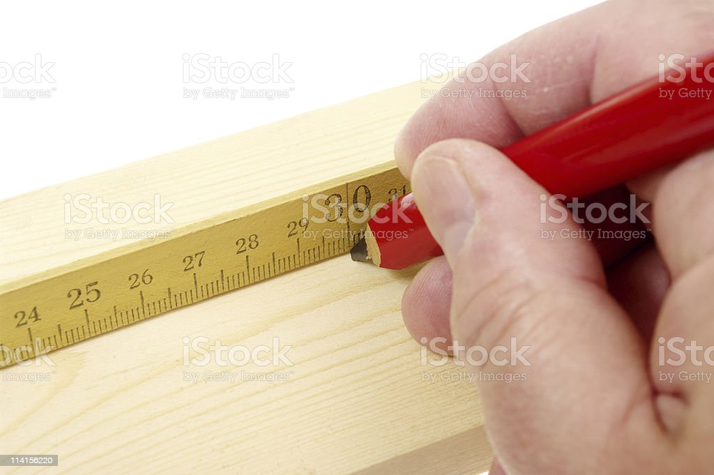 Making Mark On Timber With Carpenter's Pencil stock photo