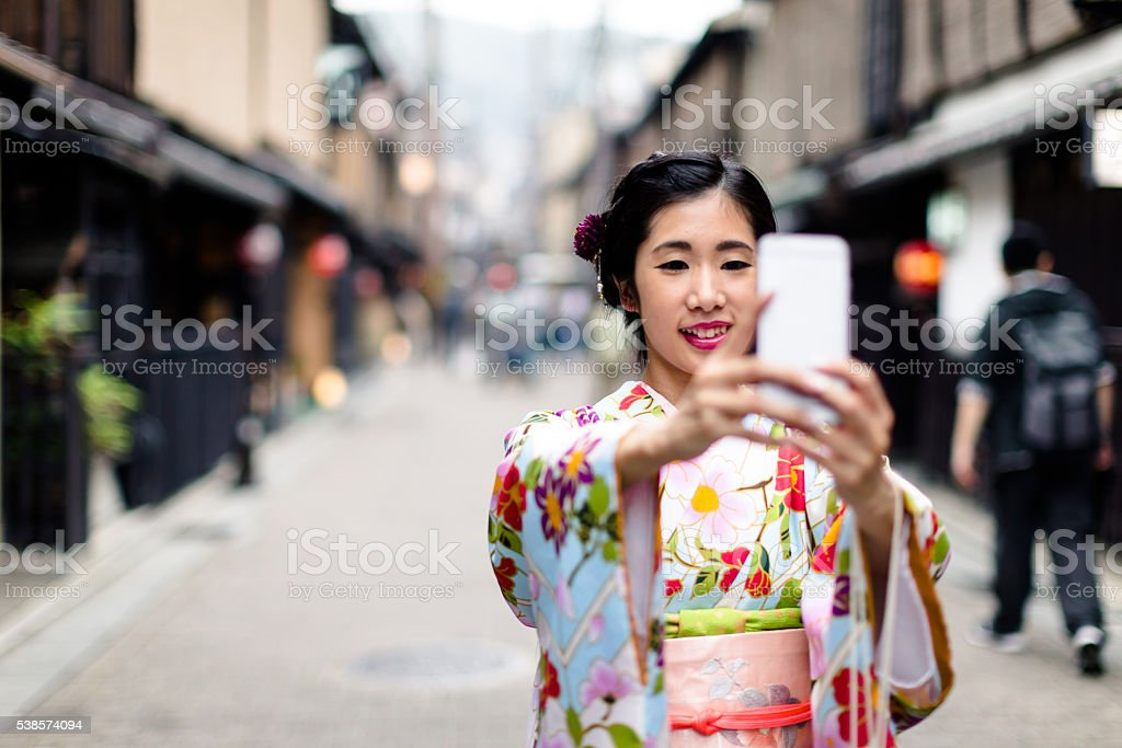 Making Memories from Japan, Japanese Girl in Kimono taking Selfie stock photo