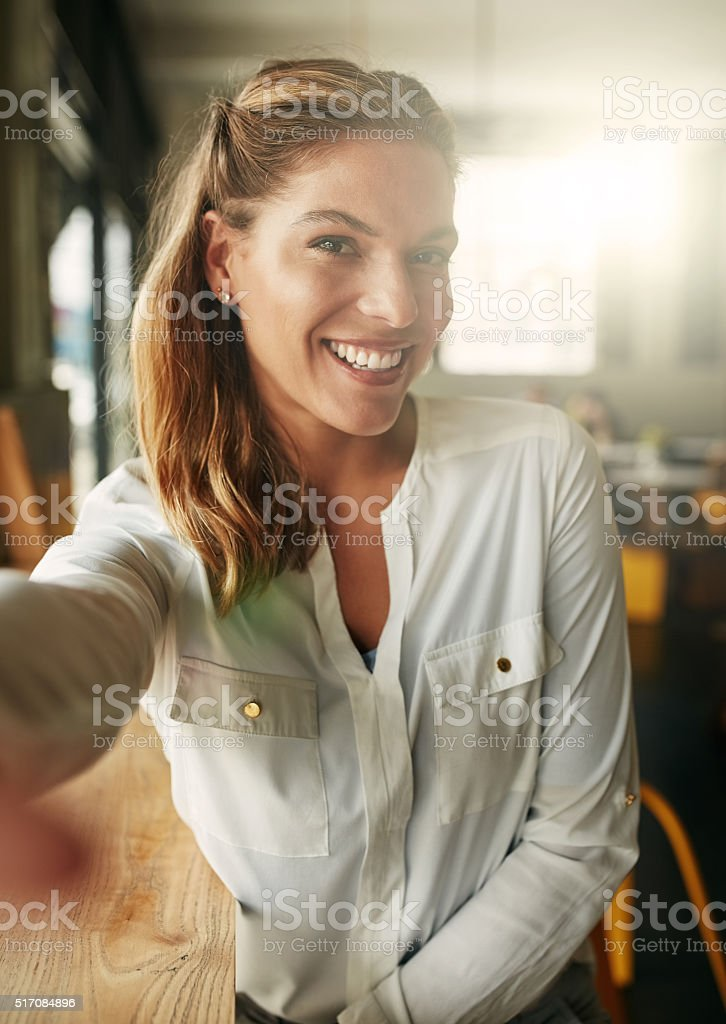 Making memories in her favourite cafe stock photo