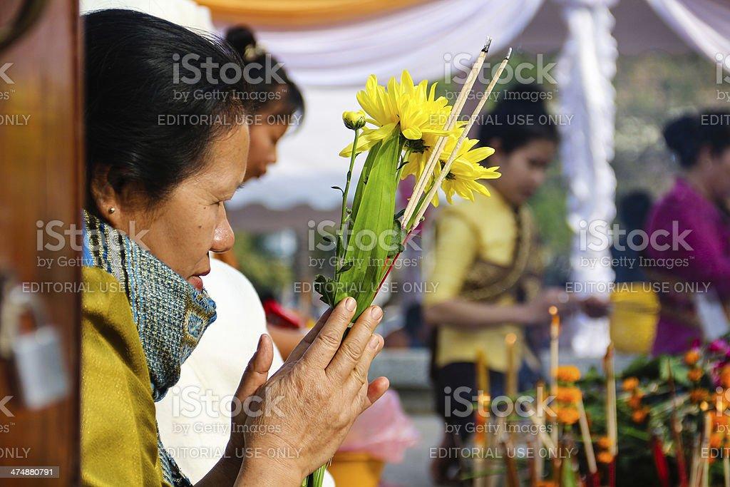 Making Merit in Laos stock photo