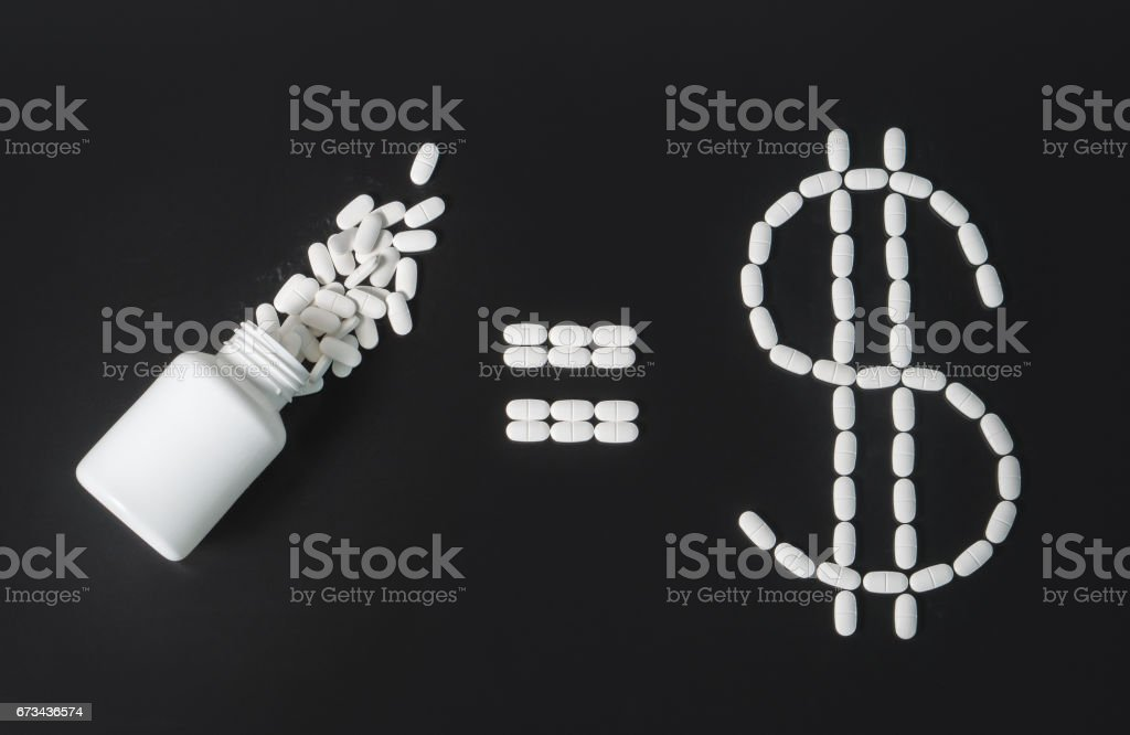 Making money in pharmaceutical industry or high medical expenses. Pill bottle equals dollar sign written with pills. Medical business or prices concept. stock photo