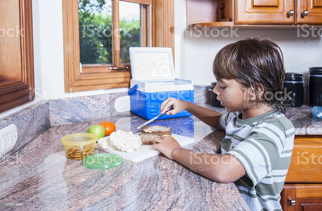 Making my school lunch in the kitchen . royalty-free stock photo