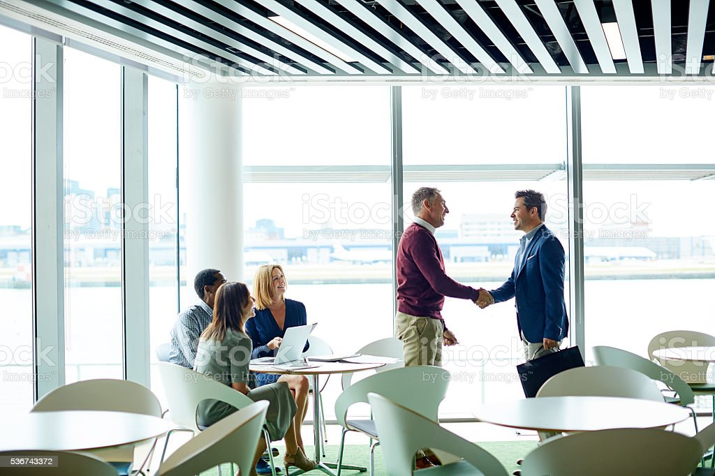 Making new business deals in departures stock photo