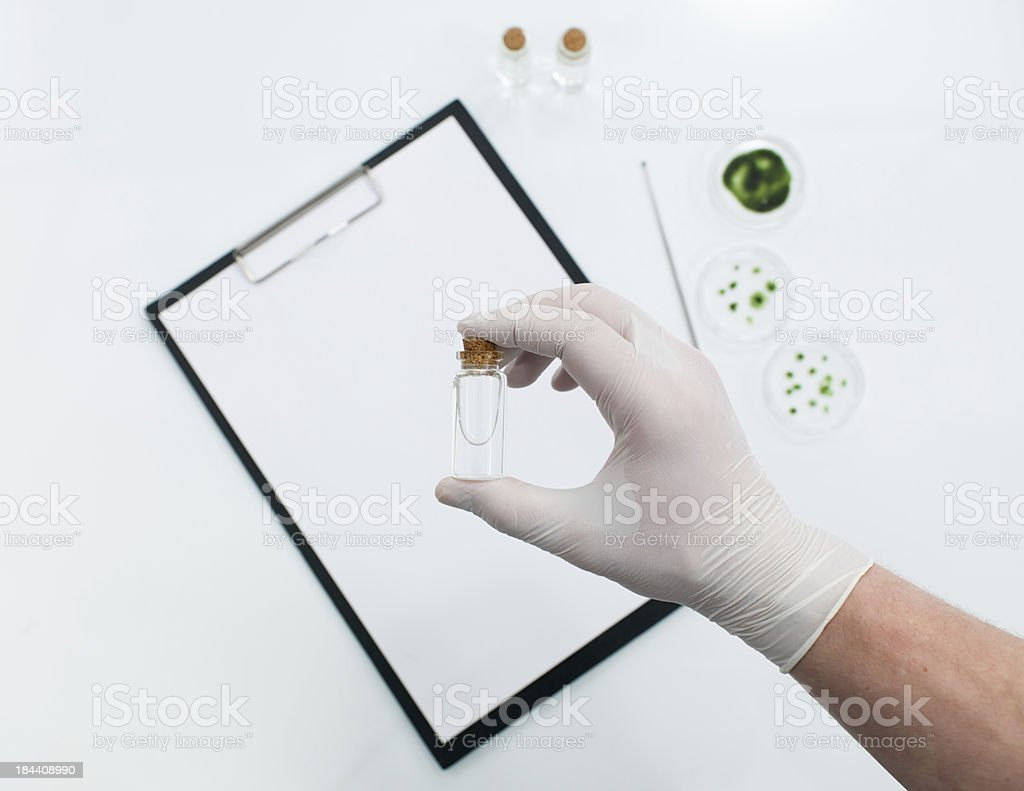 making notes about biological and chemical substances royalty-free stock photo