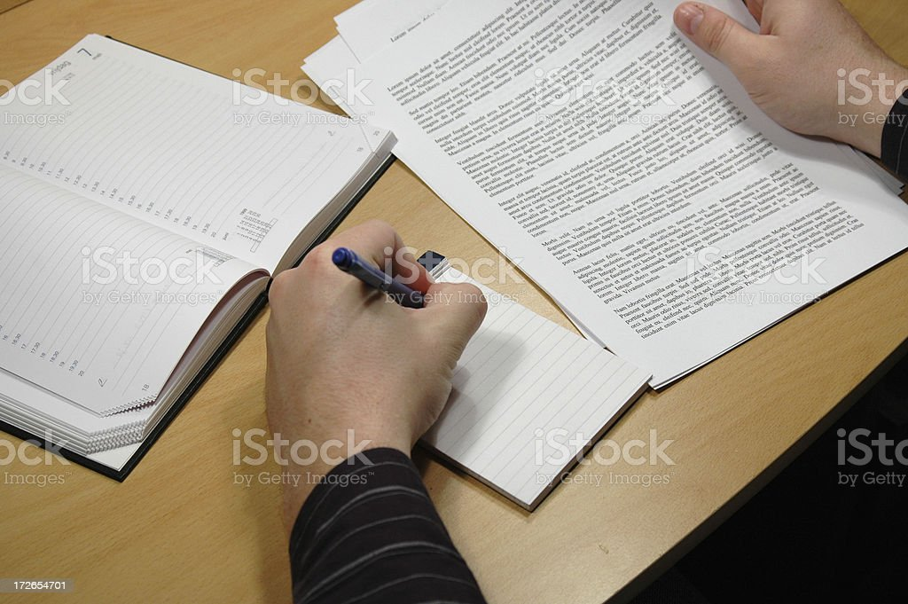 Making notes during work royalty-free stock photo