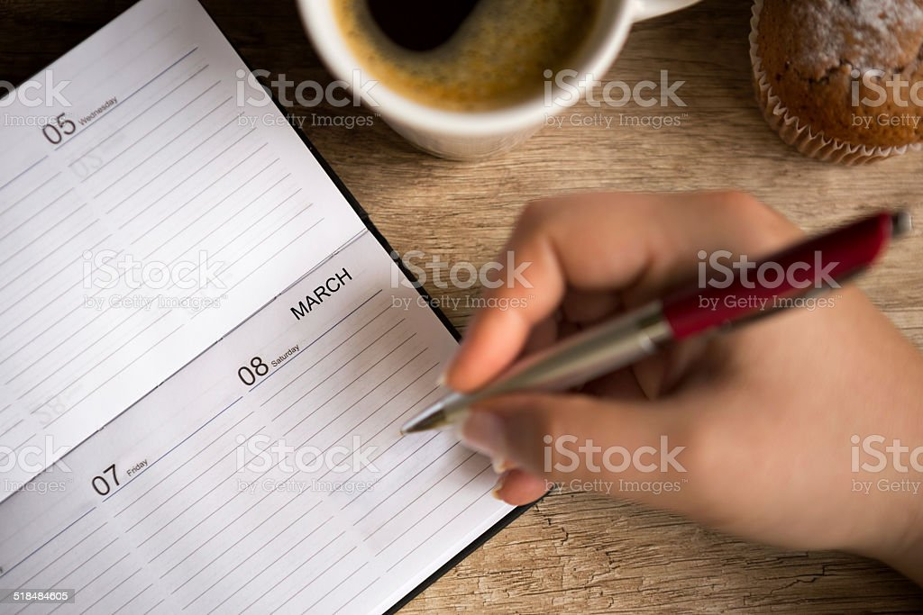 Making  notes for  8 March stock photo
