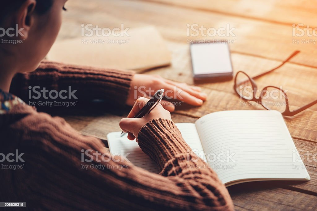 Making notes. stock photo