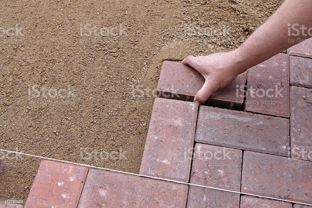 making of a block paving driveway royalty-free stock photo