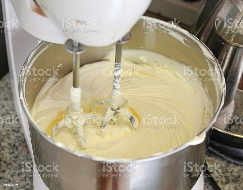 Making of a cream for home-made cakes on a mixer stock photo