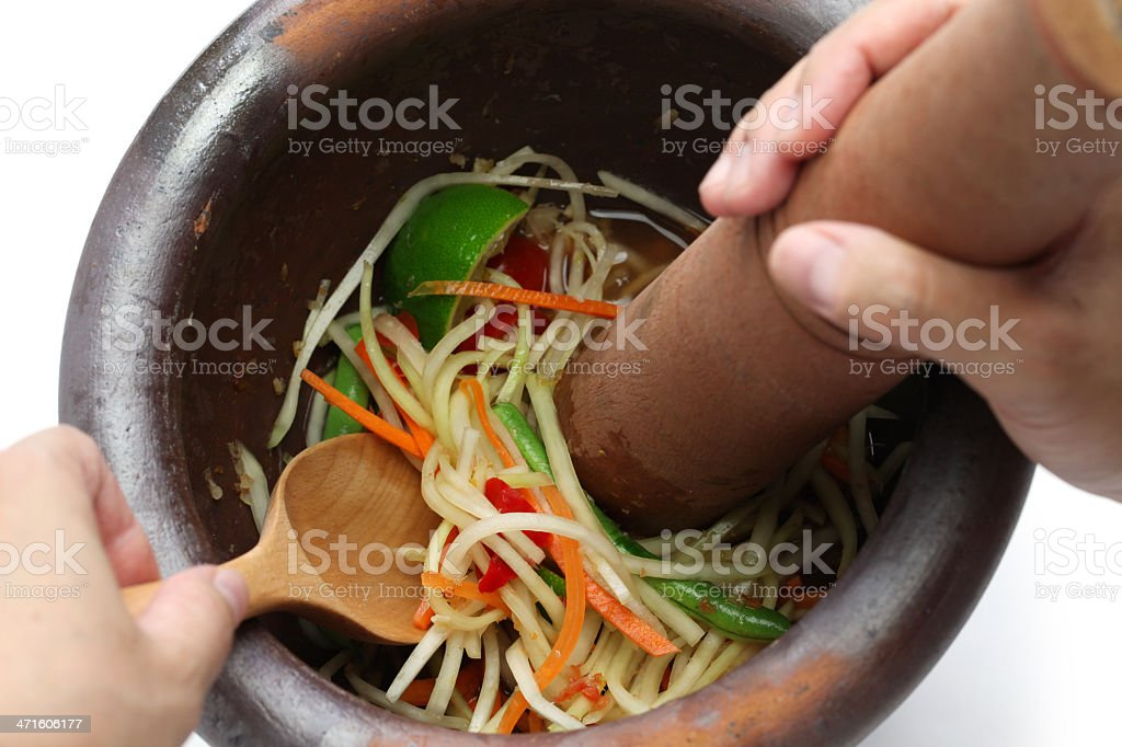 making of green papaya salad, som tam, thai food royalty-free stock photo