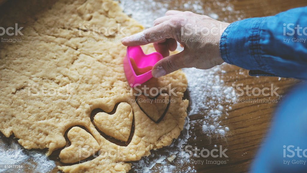 making of heart shape cookies stock photo