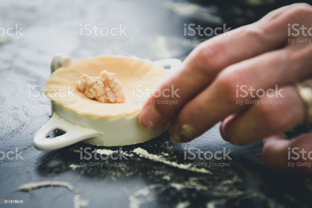 Making of homemade dumplings pastry tortellini or ravioli stock photo