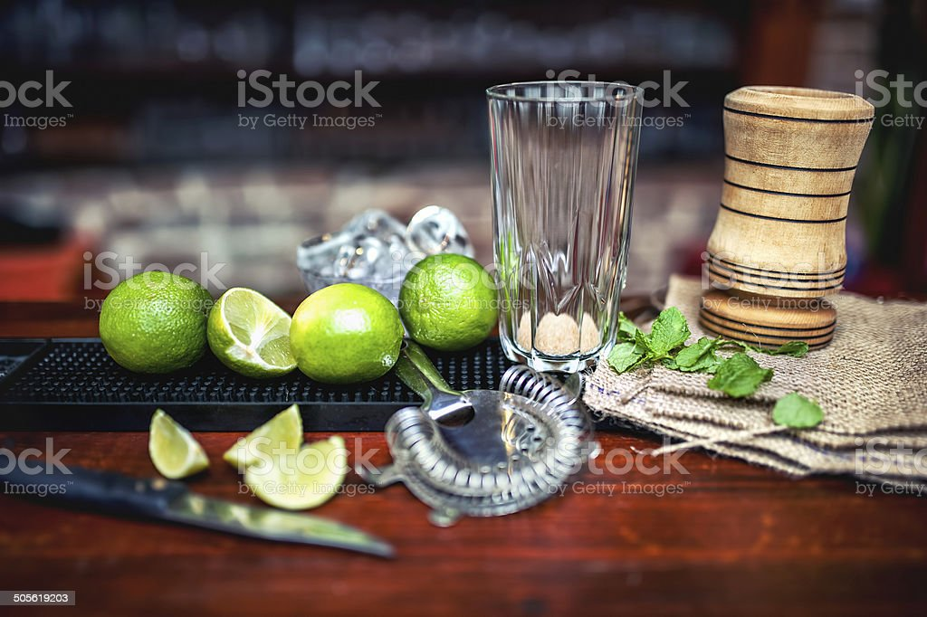 making of ice cold fresh mojito cocktail. Empty glass stock photo
