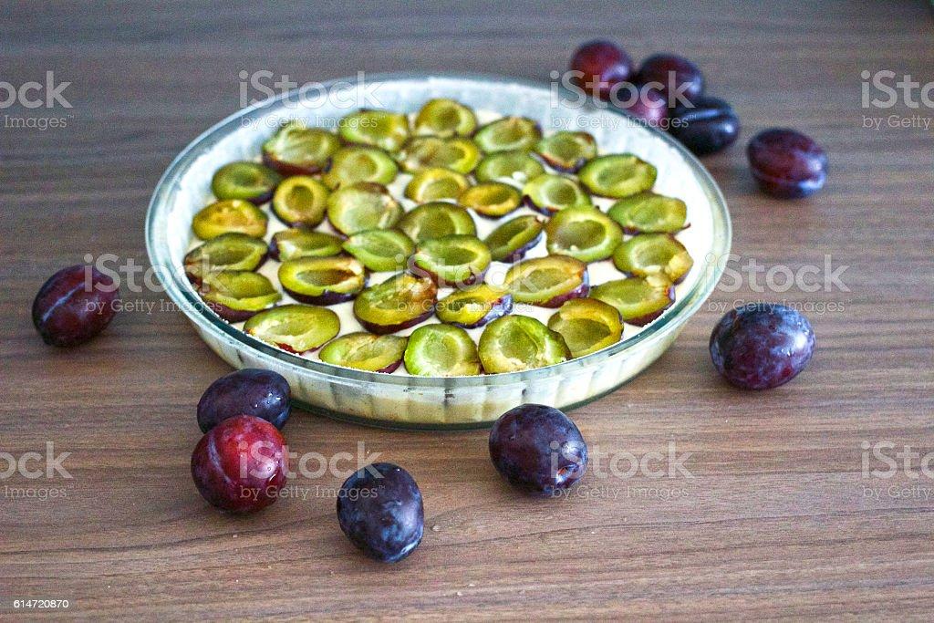 Making of plum pie stock photo