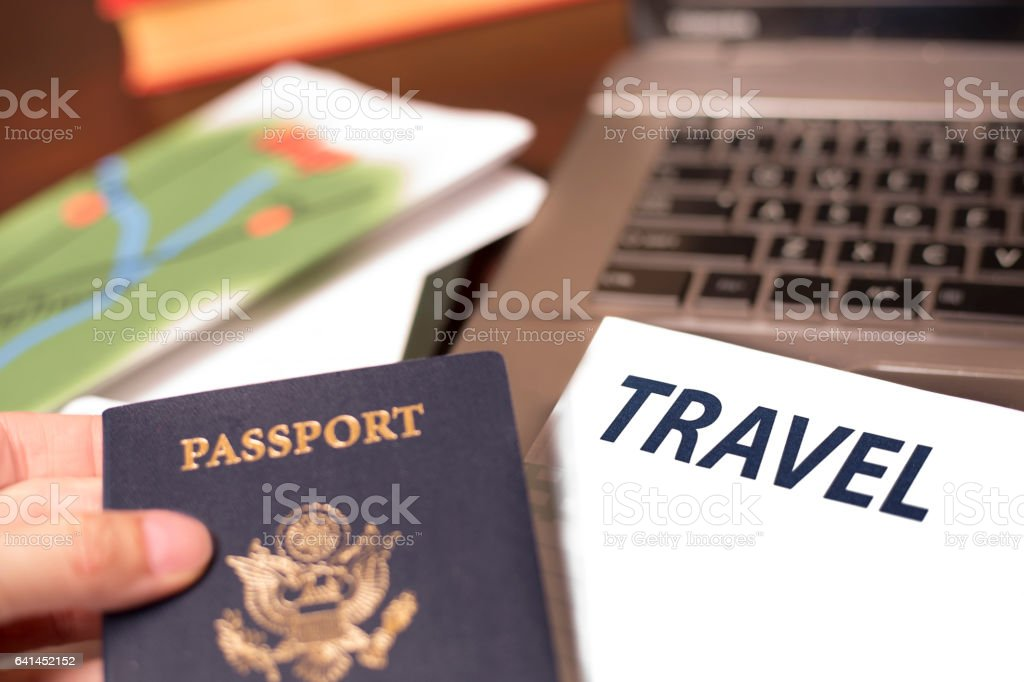 Making online travel reservations using laptop computer stock photo