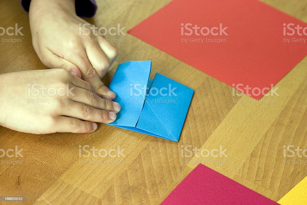 Making Origami royalty-free stock photo