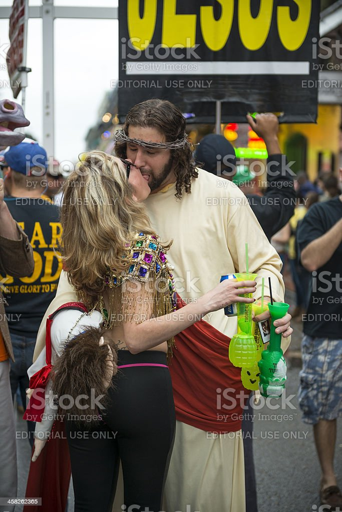 Making out at Mardi Gras royalty-free stock photo