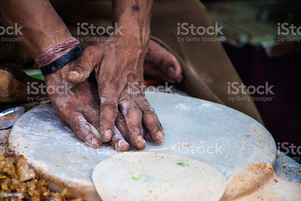 Making parathas stock photo