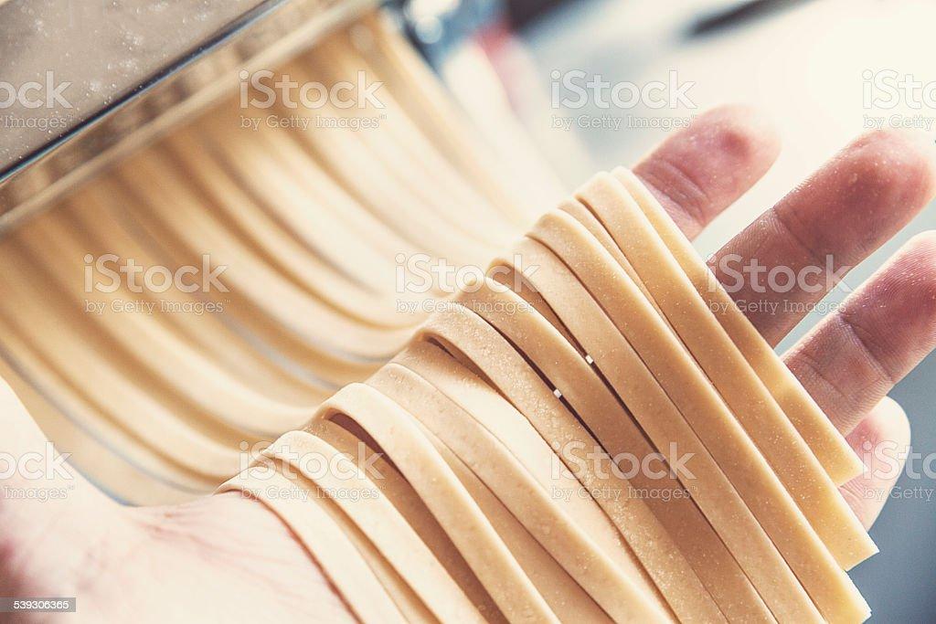 Making pasta! stock photo