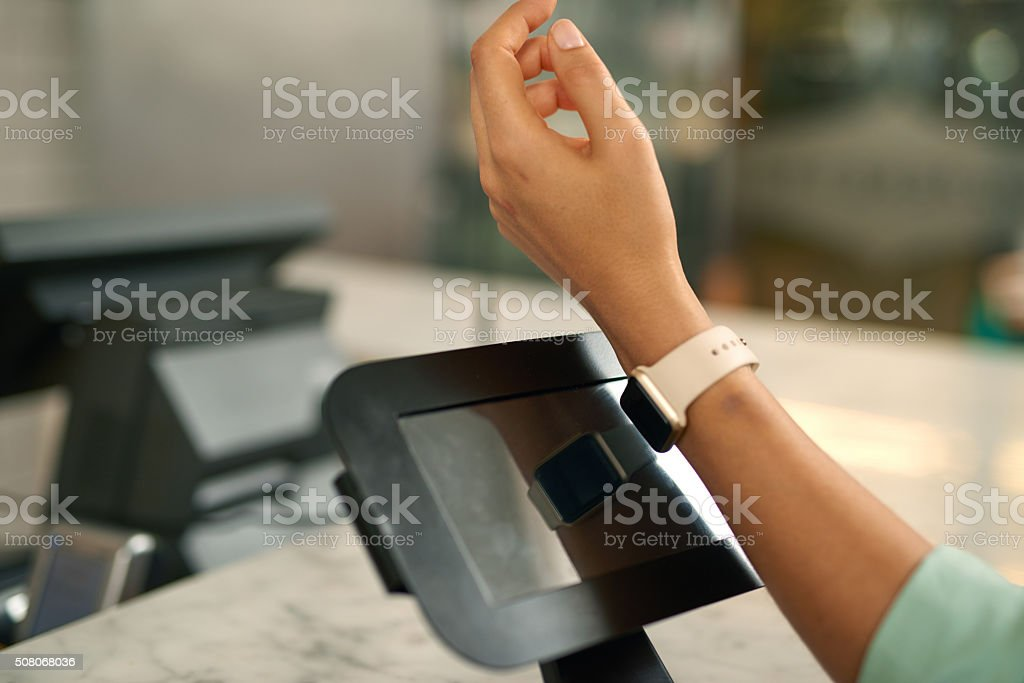 Making payment through smartwatch stock photo