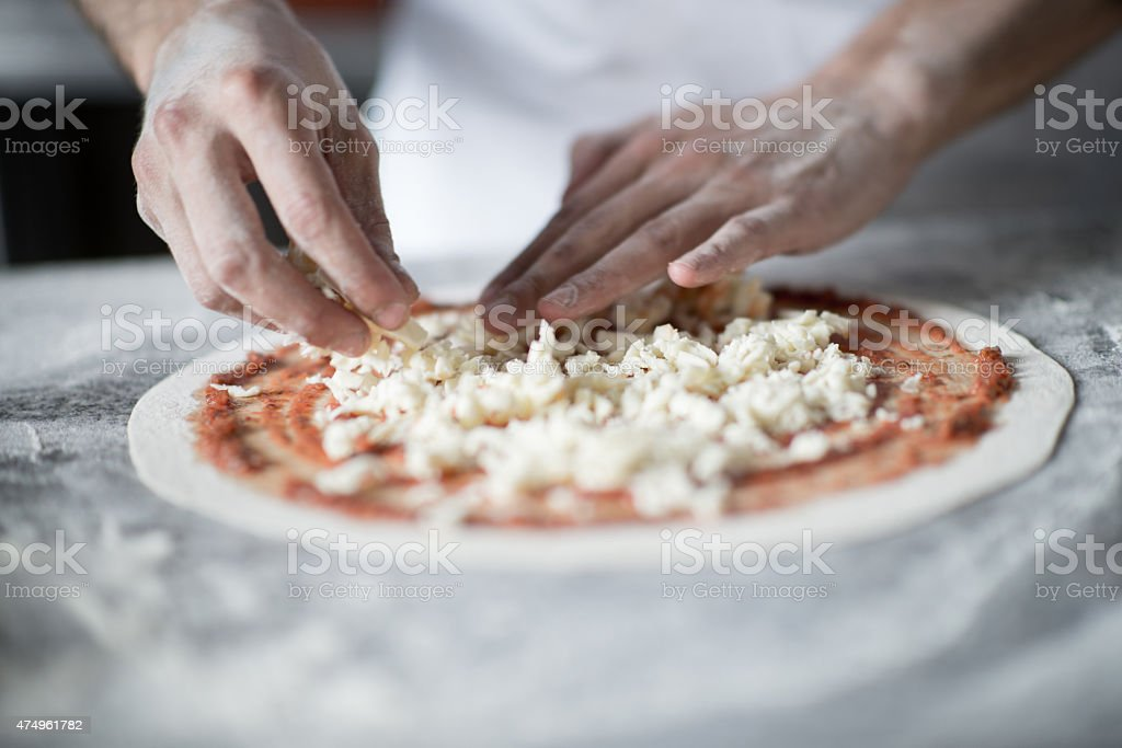 Making pizza at an Italian restaurant stock photo