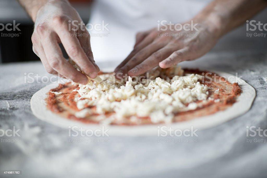 Making pizza at an Italian restaurant stock photo
