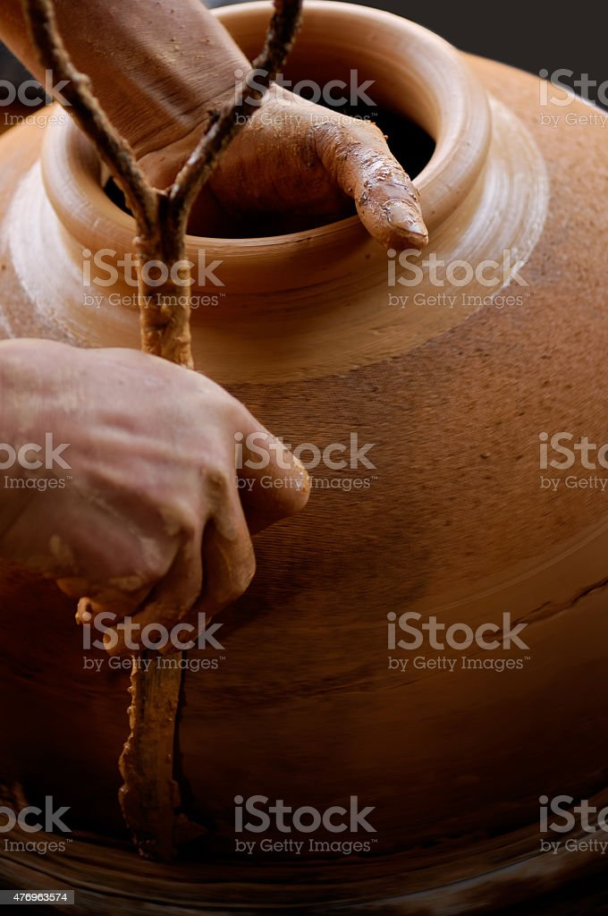 Making pottery with hands in the workshop stock photo