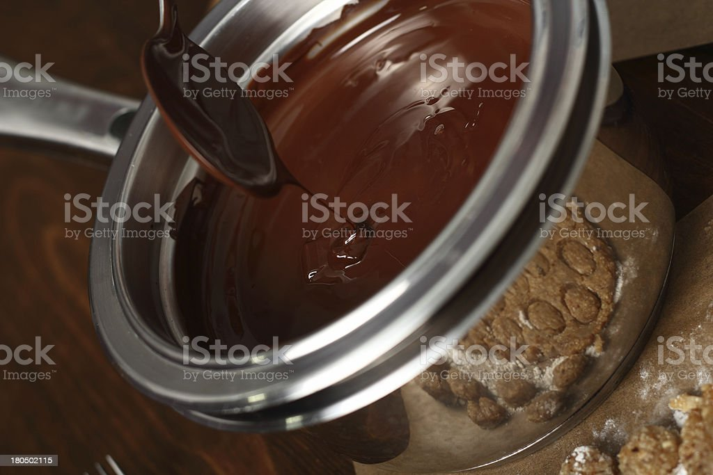 Making Praline (Chocolate Candy with Nut Filling) stock photo