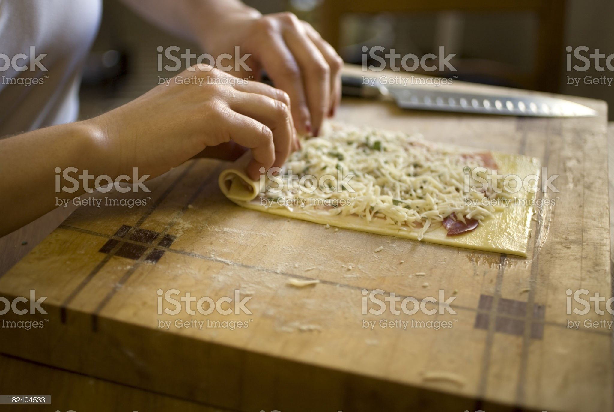 Making puff pastry cheese rolls royalty-free stock photo