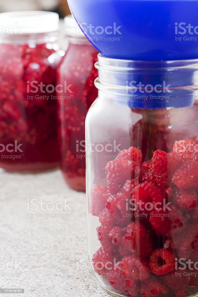 Making Raspberry Cordial - Raspberries In The Jar royalty-free stock photo
