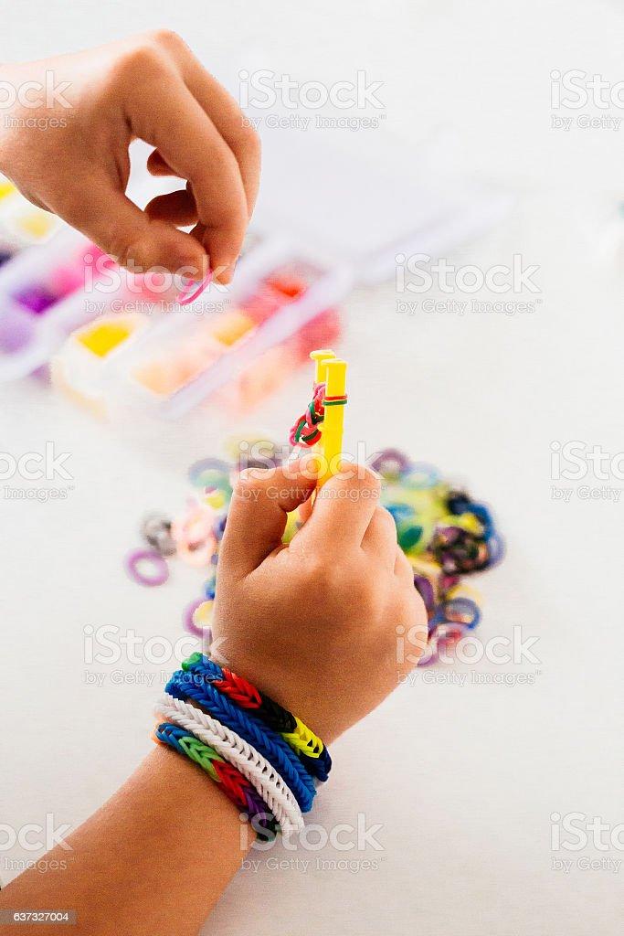 Making rubber bands bracelet stock photo