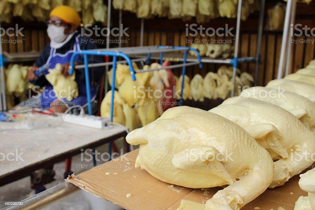 Making rubber chicken stock photo
