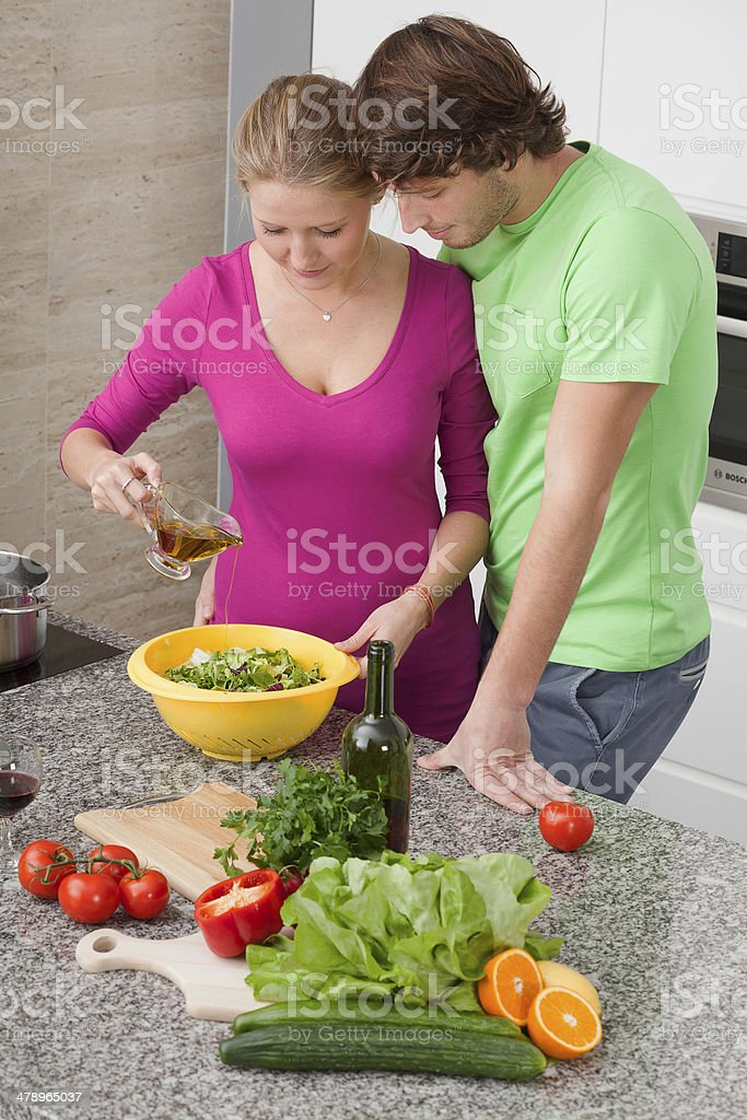 Making salad with olive oil royalty-free stock photo
