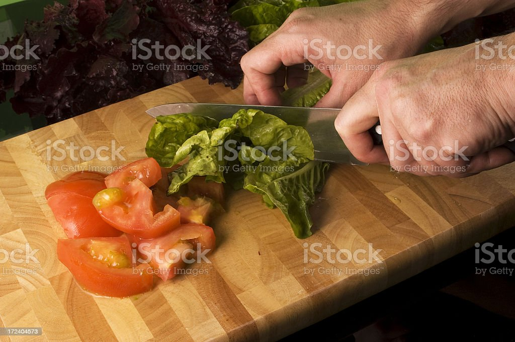 Making Salad with tomato and lettuce royalty-free stock photo