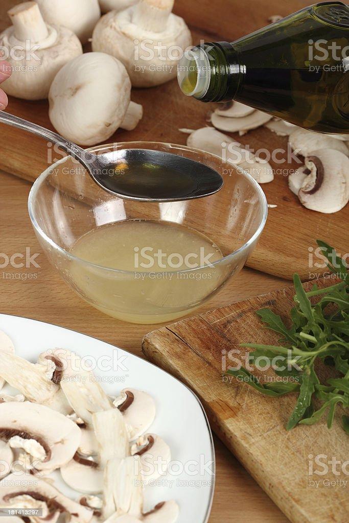 Making Salmon Carpaccio with Mushrooms royalty-free stock photo