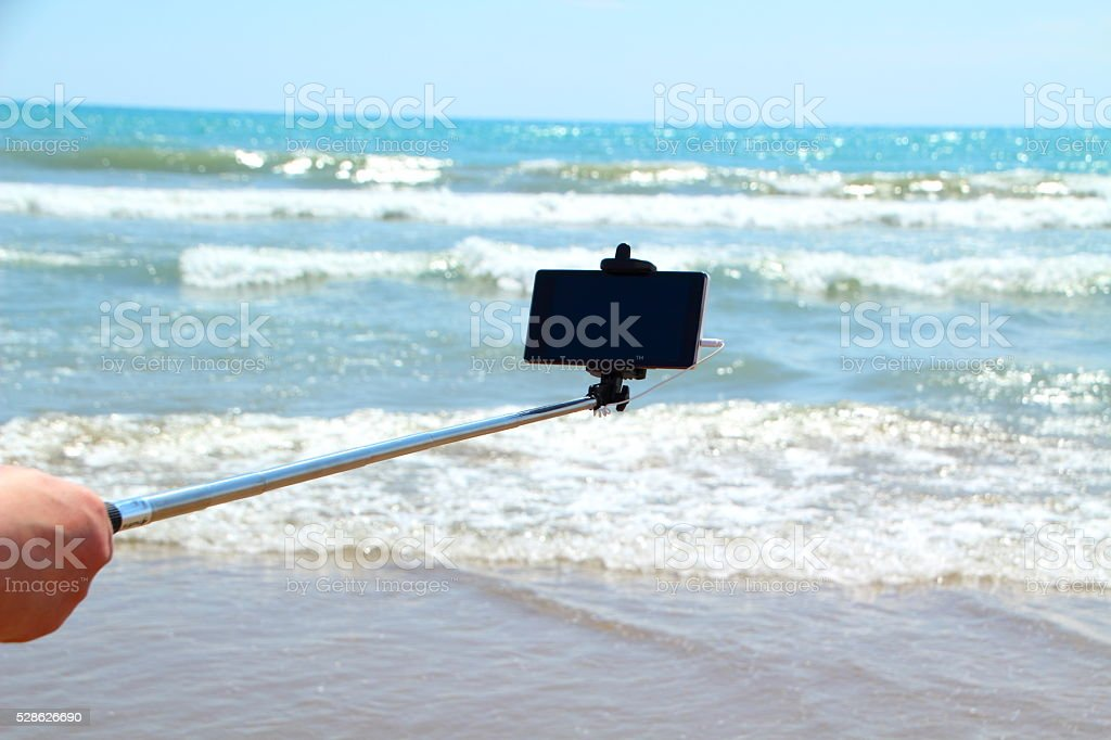 making selfie on the beach stock photo