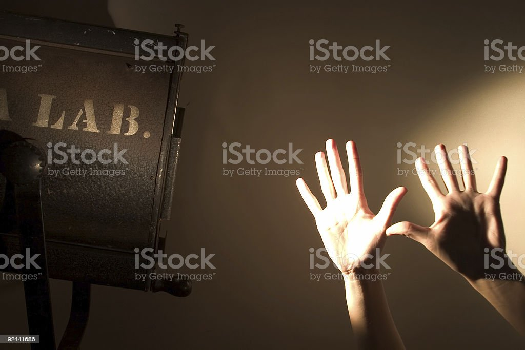 Making Shadow Puppets With Antique Stage Light royalty-free stock photo