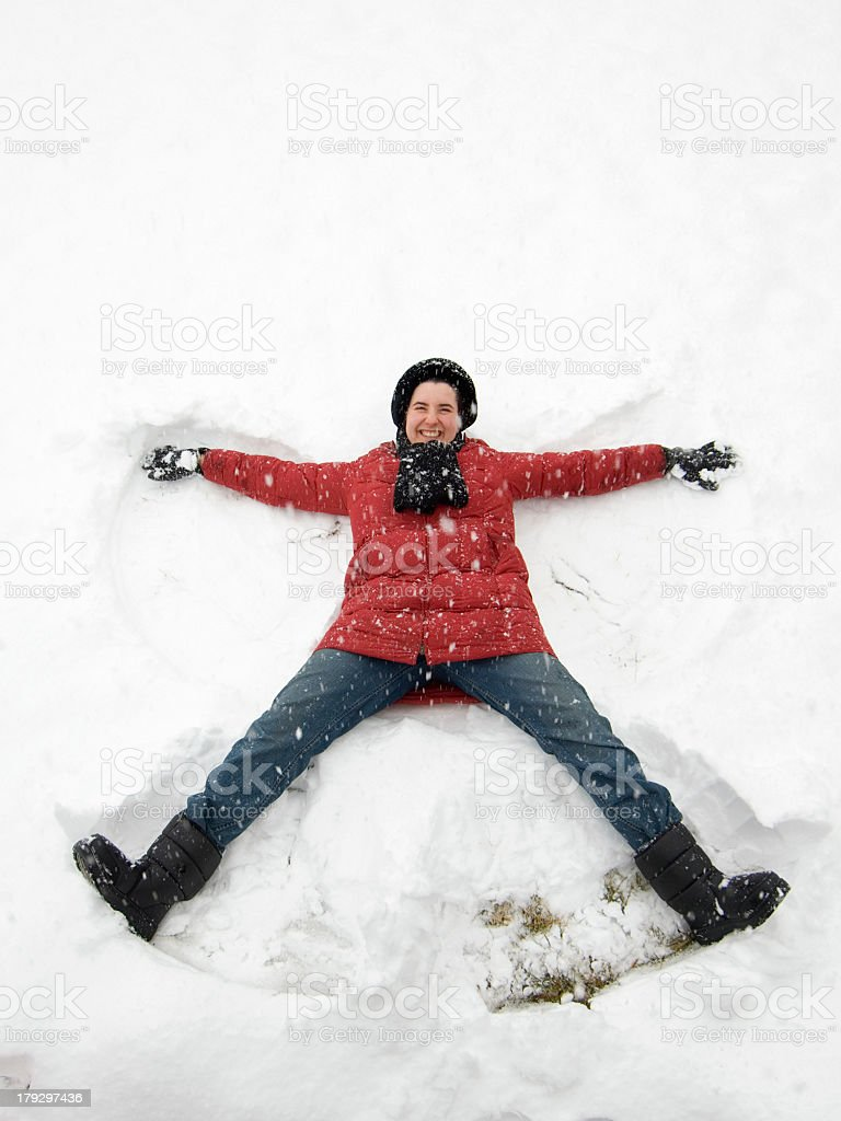 Making Snow Angel royalty-free stock photo