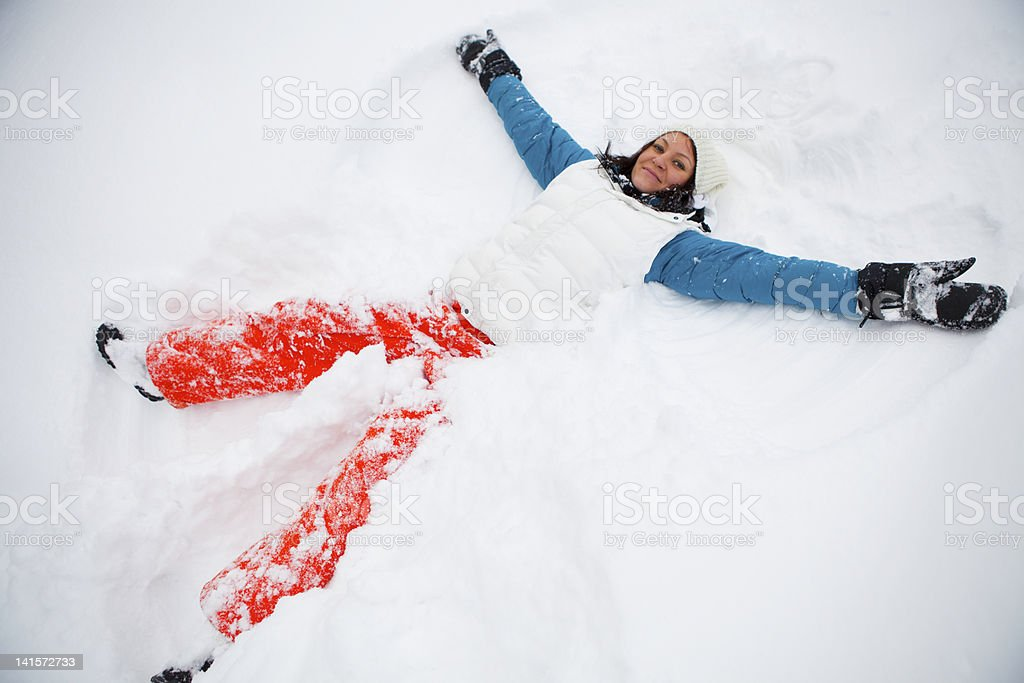 Making snow angels royalty-free stock photo