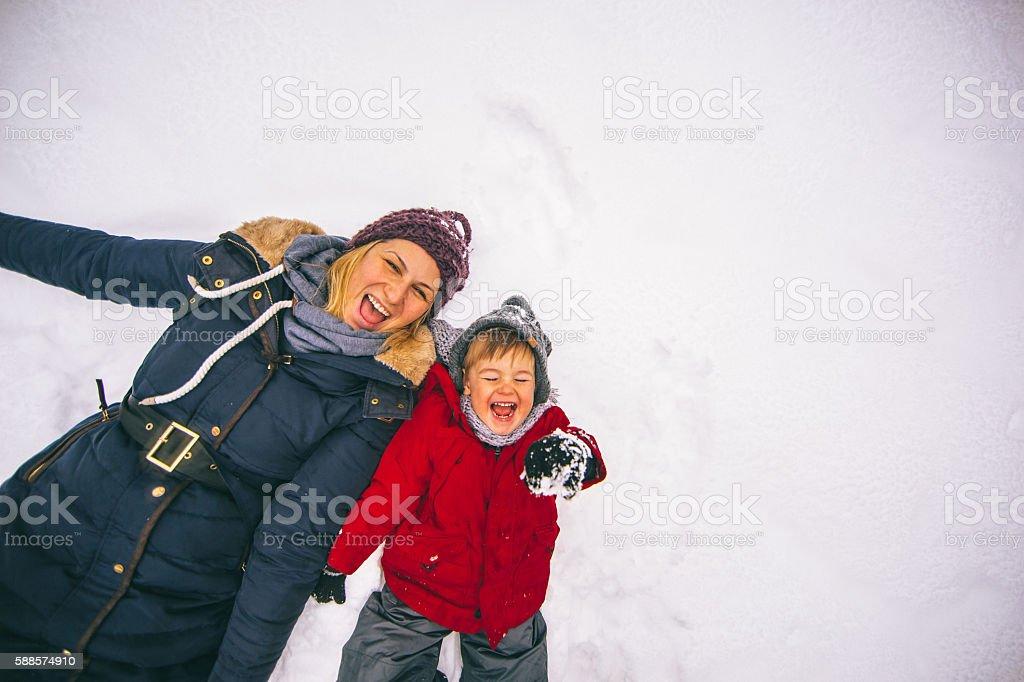 Making snow angels stock photo
