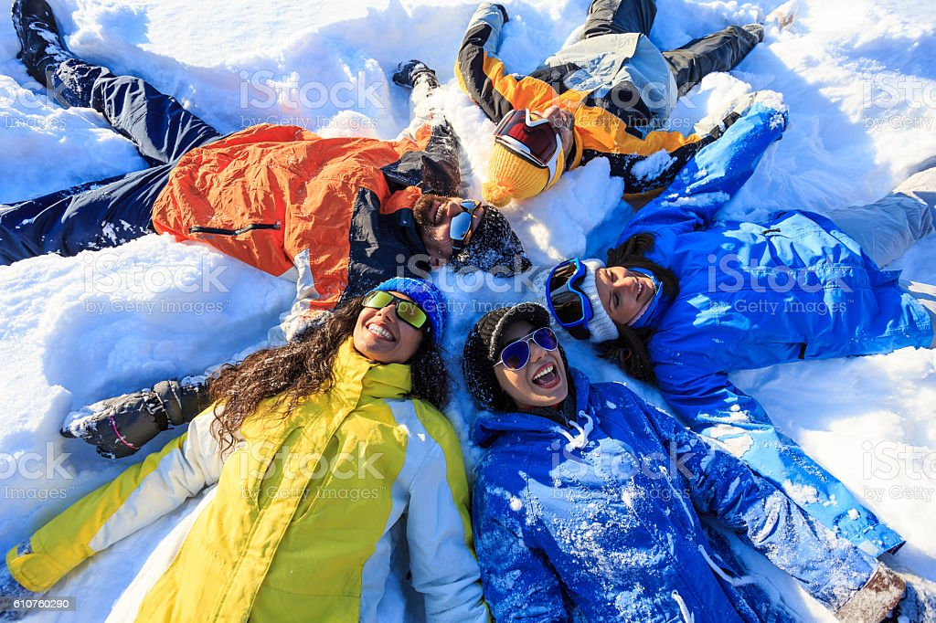 Making snow angels with friends stock photo