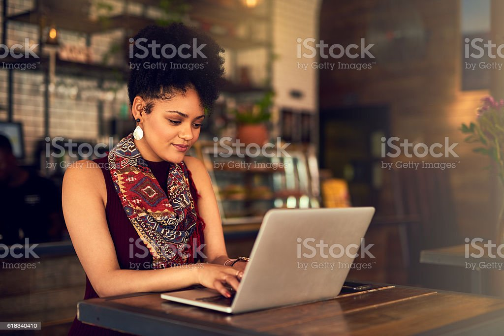 Making some final edits to her latest blog post stock photo