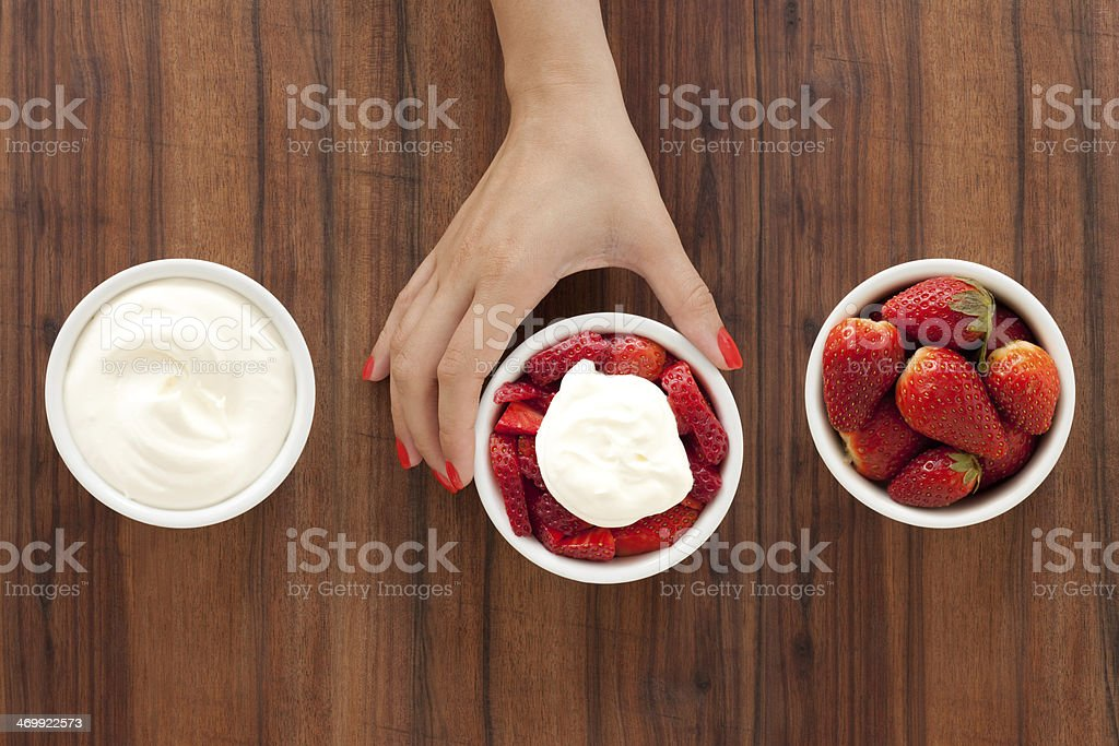 Making strawberries and cream royalty-free stock photo