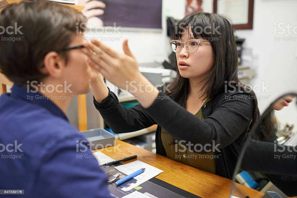 Making sure he has 100% vision stock photo