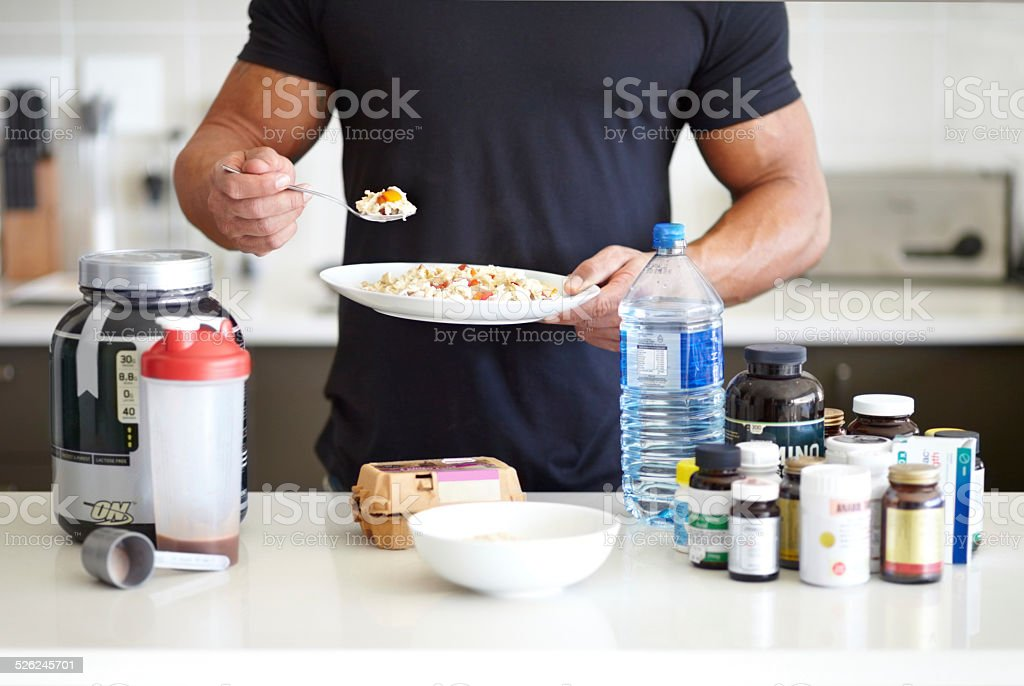 Making sure he has all his vitamins and minerals stock photo
