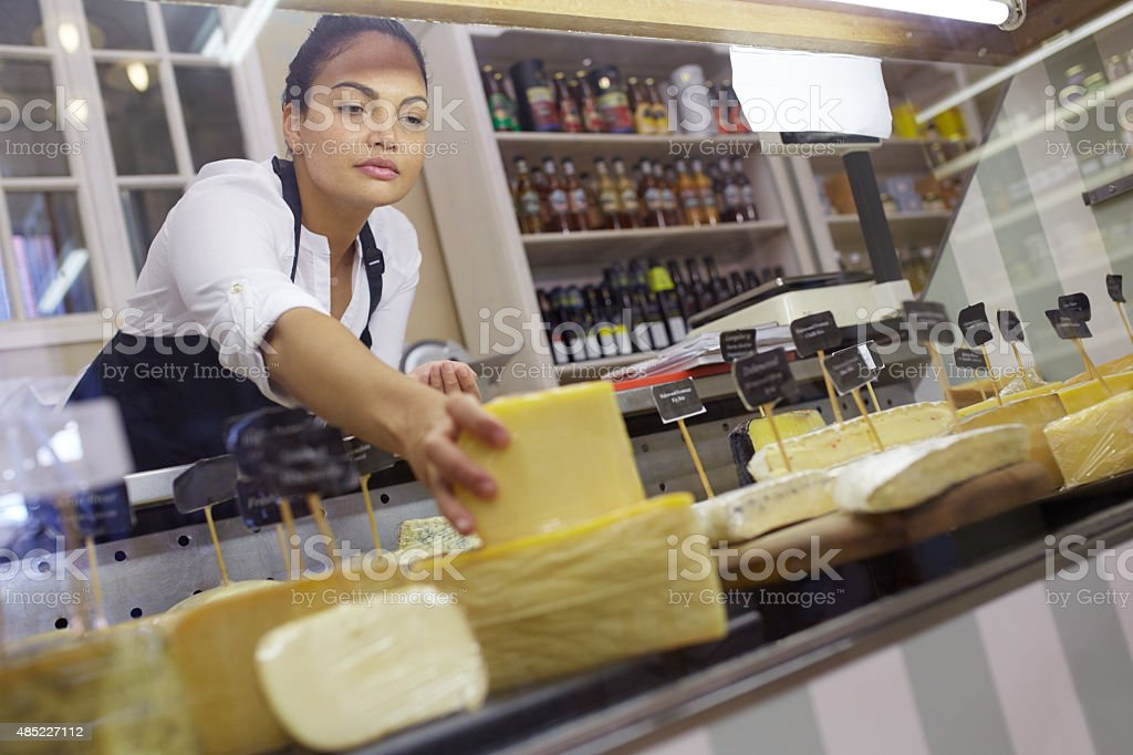 Making sure her cheese display is perfect stock photo