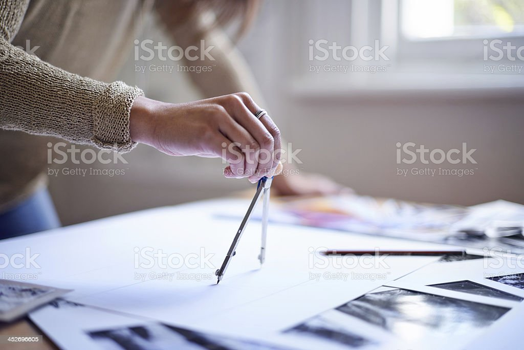 Making sure her design is perfect stock photo