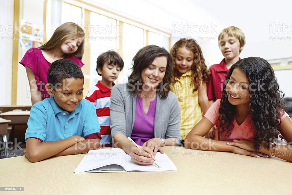 Making sure her students are on the same page royalty-free stock photo